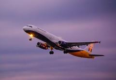 Blue Hour Take off. (GEORGE TSIMTSIMIS) Tags: aircraft airbusa320 corfu lgkr takeoff monarch airliner clouds bluehour pentaxk10d pentaxsmc