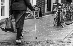 Walking (City Scenes 3 of 4) (+Pattycake+) Tags: candid street people panasonic norwich winter city mirrorless lumixdmcgm1 43 bike paving pavingstones walkingstick