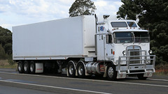 The White Kenworth (3/3) (Jungle Jack Movements (ferroequinologist)) Tags: kenworth sar k124 ken kenny kw k100 highway hauling haulin hume sydney 2019 yass classic historic vintage veteran hcvca vehicle run hp horsepower big rig haul haulage freight cabover trucker drive transport delivery bulk lorry hgv wagon nose semi trailer deliver cargo interstate articulated load freighter ship move roll motor engine power teamster tractor prime mover diesel injected driver cab wheel