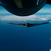 A B-2 Spirit bomber conducts aerial refueling near JBPHH, Hawaii, during an interoperability training mission