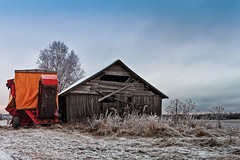 Potato Harvester By An Old Barn (k009034) Tags: agriculture baretree barn barnhouse branches building clouds cold copyspace country countryside farm farming fields finland frost grass harvesting landscape machine nature nopeople old potato red rural scandinavia scene scenic sky tool tranquilscene trees winter wooden