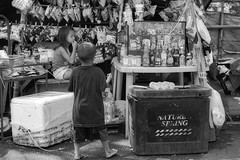 Minding the Store (Beegee49) Tags: children boy street girl snacks selling blackandwhite monochrome bw luminar sony a6000 happy planet bacolod city philippines asia