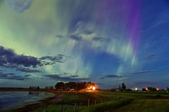 Midsummer nights dream aurora (John Andersen (JPAndersen images)) Tags: aurora barn bluehour calgary canon cityskyline evening farm summer trees twilight