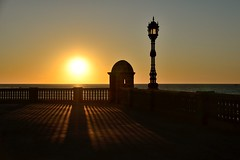Light vs Gloom.. (Raquel Borrrero) Tags: cádiz luz puestadesol garita mar sombra nostalgia light gloom sunset sea sun fence españa andalucía shadow