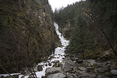 Lower Reid Falls in Spring (i threw a guitar at him.) Tags: alaska 2019 spring national park klondike skagway nature wild landscape mountains waterfall frozen snow ice scenic trail lower reid hike hiking freeze gorge ravine stone mountain rock moss tree view below bottom beneath free creative commons