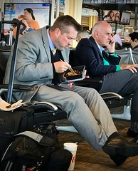Chopsticks (LarryJay99 ) Tags: airport crossedlegs dude dudes guy guys handsome male man manly masculine men people profile seated studly suits virile eating waiting chopsticks backpacks candid stranger unsuspecting unposed sliceoflife