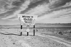 welcome to searles valley. trona, ca. 2018. (eyetwist) Tags: eyetwistkevinballuff eyetwist sign roadside trona welcome searlesvalley landscape mojavedesert bw black white monochrome film analog 6x9 blackwhite fujifilm gsw690iii fujinon 65mm f56 fujifilmgsw690iii fujinon65mmf56 fujiacros100 fuji acros 100 ishootfilm ishootfuji analogue emulsion mediumformat 120 filmexif iconla epsonv750pro lenstagger xtol gsw 690 iii typology texasleica mojave desert california dry arid highdesert american west lonely wide angle sand rock dust road searles lake borosilicate mining railroad typography typographic elkslodge vast empty minerals ridgecrest pinnacles potash sodaash borax