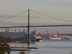 Overlooking a Cold Port of Vancouver ... (Irene, W. Van. BC) Tags: overlookingacoldportofvancouver vancouverbc portofvancouverbc burnabybc westvancouverbc burrardinlet water waterscenes waterreflections ocean oceanwater oceanscenes beautifulnature cold communitiesofvancouverbc sky skies skyline skyscenes awesomenature awesomeskies wonderfulnature boats shipsandvessels trees treesilhouettes 1001nights 1001nightsmagiccity 1001nightsmagicwindow cranes shipyard transportships clouds