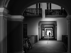 gateway (heinzkren) Tags: durchgang wien vienna gangway building architecture architektur human city schwarzweis blackandwhite monochrome urban panasonic lumix street streetphotography mood lines shadow light modern old silhouette skancheli