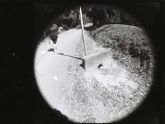 Drain (Matthew Paul Argall) Tags: lomographybabyfisheye fixedfocus 110 110film subminiaturefilm lomographyfilm blackandwhite blackandwhitefilm fisheyelens