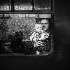 Hold on tight (Wendy G Davies) Tags: blackandwhite bnw mono monochrome son father strangers portrait candid passengers baby steam train watercressline