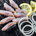Sliced salted herring with lemon and onion. Top view. Healthy food