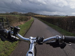 Cycling on a Blustery Day (cycle.nut66) Tags: cycling ride riding handlebars road country lane hill woods hedges sky clouds levers shifters blustery march olympus epl1 evolt micro four thirds mzuiko