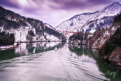 Beautiful landscape from Shogawa Gorge Cruise. A cruise ship on the Shogawa. Toyama is located in Japan. Feb 2, 2019. (pomp_jaideaw) Tags: shogawa landscape river valley winter toyama japan beautiful view mountain nature snow bridge red white water cold asia morning japanese village snowy canal hida green background traditional ancient landmark lake peace famous boat historical residential pine heritage waterfall unesco cottage glory waterway shirakawa gokayama prefecture ogimachi blue cruise color