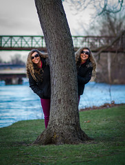 Introducing Wanda and her long-lost twin sister! (tquist24) Tags: elkhart hww indiana islandpark nikon nikond5300 stjosephriver wanda bridge geotagged girl grass park photoshop portrait pretty river smile sunglasses tree trees water woman