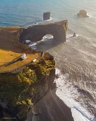 Dyrholaey Lighthouse (Donald Y) Tags: red iceland dyrholaey lighthouse beach cliffs seascape sunset drone aerial dji mavic air