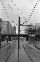 Berlin 3 (Lennart Arendes) Tags: canon eos 1n kodak trix 400 film analog 35mm kb f4 d76 berlin alexanderplatz street rails bridge rain people