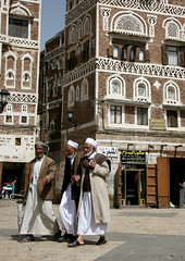 Three Men Walking Through The Bab Al Yemen, Sanaa, Yemen (Eric Lafforgue) Tags: adult ancient arabia arabiafelix arabianpeninsula architectural architecture babalyemen building builtstructure colourpicture day fulllength historical history housing islam man muslim oldcity placeofinterest realpeople residentialstructure sana sanaa street threepeople togetherness traditionalarchitecture traditionalculture traveldestination turban unescoworldheritagesite vertical window yemen yemeni 0062yemenlafforgue