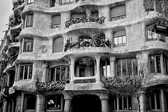 You look beautiful in black and white too (Fnikos) Tags: sky building architecture construction facede decor decoration column wall window door balcony modernismo gaudí antonigaudi lapedrera barcelona blackandwhite monochrome outdoor