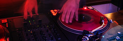 hand of dj on vinyl disk in red light (IrisPhotoStudio) Tags: music record vinyl dj turntable cd sound player audio dvd party disco laser technology disc equipment retro light club disk entertainment black nightclub night gramophone panorama panoramic 31 poland