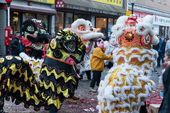 The little piggy is surrounded by dragons. (kuntheaprum) Tags: chinatownboston chinesenewyearcelebration yearofthepig sony a7riii tamron 2470mm f28 festival parade dragon firework