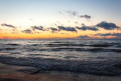 Lake Michigan Sunrise (Schwaco) Tags: lake michigan door county wisconsin water waves clouds shore sand beach coast cloudscape landscape lakescape sunrise sunset early sun glow orange red yellow sky blue dawn rise