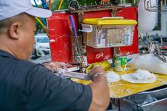 Famous Vietnamese Dessert Bo Bia sold in Ho Chi Minh City, Vietnam (wuestenigel) Tags: tongs friedfishball sausage scissors cigarettes foodcart milk hochiminhcity bobia vietnamesesnack money condensedmilk crescentlake vietnam vietnamesefood streetfood motorbike saigon dessert people menschen man mann industry industrie adult erwachsene production produktion vehicle fahrzeug festival wear tragen food lebensmittel outdoors drausen business geschäft commerce handel market markt grinder schleifer daylight tageslicht grow wachsen election wahl religion one ein service bedienung
