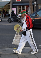 It's a look (jeremyhughes) Tags: london man hat feather redwhitegreen red white green tracksuit allinwhite robinhood lampshade street candid eccentric style itsalook sneakers fannypack shoppingbag city urban character nikon d750 nikkor 80200mmf28