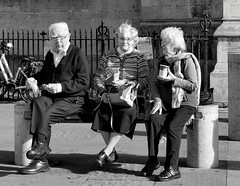 I hear a new voice (sasastro) Tags: candid bench people poster streetphotography cambridgeuk