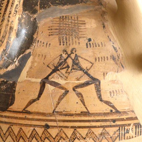 Argive Late Geometric monumental globular pyxis (detail 4: wrestlers under handle)
