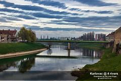 Downtown by the river Kupa (malioli) Tags: citytown sky river water bridge huse clouds canon karlovac kupa croatia hrvatska europe