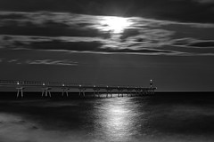Full moon - Silver coated (Fnikos) Tags: sea water mar mare ocean luna moon fullmoon lunallena landscape sky cielo cloud nube skyline seascape dark architecture construction puente pont pier light lights reflection night nightview nightshot longexposure silver blackandwhite monochrome absoluteblackandwhite outside outdoor