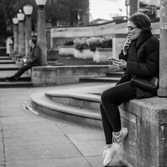 Relaxation (+Pattycake+) Tags: ©patriciawilden2019 blackandwhite spring mobilephone people candid cigarette street smoker primelens norwich city 40mmprimelens uk norfolk canoneos70d