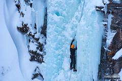 Abisko Ice Climber (kevin-palmer) Tags: abisko sweden swedishlapland arctic march winter cold snow snowy ice icy frozen icefall waterfall canyon climber climbing rope nikond750 europe abiskoriver scandinavianmountains cliffs nikon180mmf28 telephoto