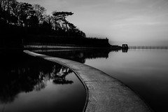 walking on water... (Jess Feldon) Tags: seaside coast somerset clevedon bigstopper longexposure lookslikefilm jessfeldon monochrome blackandwhite path water boatinglake fence happyfencefriday hff