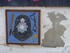 Skelton mosaic police (Nekoglyph) Tags: skelton cleveland mosaic publicart tiles wall street found mouse white police badge helmet truncheon blue black handcuffs key grey shape peeling paint