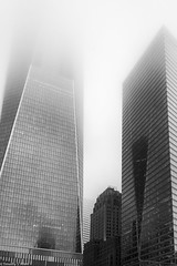 The New Surrounding the Old (allentimothy1947) Tags: bw groundzero manhattan newyorkstate worldtradecenter architecture blackandwhite buildings cloudy fog lowclouds memorial newyorkcity rain reflections streets transportationbuildings