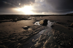 A Burst of Light at Monreith (andy_AHG) Tags: backbay monreith scotland galloway themachars wigtownshire northernbritain outdoors walking rambling rural countryside history legend folklore beach shore sea coast sunset rocks lowtide