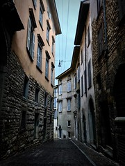 Dark autumn (Meriliis M) Tags: italy italian old street streets europe travel traveling hitchhike road pavement transit windows walls wall autumn strada strade vacation via bergamo urban design chill building buildings architecture stones iphone iphonephotography house houses home way history city explore exploring streetart nikon urbex blocks flat italia black solitary life