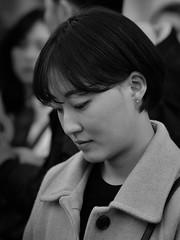 Serenity (Nikonsnapper) Tags: olympus omd em1 75mm street portrait rome bw candid coat serene shy