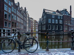 Canal Houses and Bicycle - Quintessentially Dutch (Aleem Yousaf) Tags: long exposure le houses canal overcast snow bicycle wide angle lens sky light windows explore flickr travel 1835mm amsterdam netherlands old architecture lock bridge building colours reflections nikon nikkor camera digital zeedijk lee big stopper neutral density filter bike road