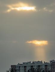 The sky is watching (bolex.ua) Tags: sunset sky light rays sun buildings evening clouds grey закат face facesinunexpectedplaces лучи облака весна лицо небо