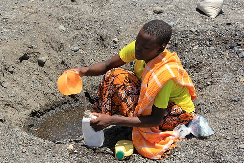 Digging for drinking water in a dry riverbed