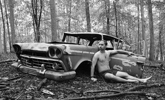 Rambler - Monochrome (seventh_sense) Tags: forest woods outdoor outdoors rain rainy afternoon nude model male man figure car automobile abandoned deserted derelict rust metal rusted rusty weathered bare portrait study tree trees leaf leaves summer hike nature natural self naked selfportrait photographer nudity wood