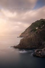 Sunrise to Riomaggiore ( Cinque National Park - Liguria // Italy ) (Yannick Lefevre) Tags: europe italy italia italie cinqueterre nationalpark liguria riomaggiore landscape seascape longexposure sunrise morning light mediteraneansea cielo mare sea clouds cliff water sky nikon nikkor hill village unesco worldheritage coast coastline