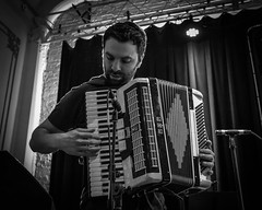 The Accordionist (tim.perdue) Tags: accordionist graceland paul simon tribute thirty one west newark ohio 31 accordion keyboard musical instrument bellows musician man person figure candid portrait stage performer entertainer backlight black white bw monochrome blackandwhite mono nikon d5500 nikkor 18105mm live performance backlit microphone mic curtain buttons buttonbox squeezebox night art napoli keys album bud light platinum series reissues concert hall venue theater explore explored interesting interestingness popular