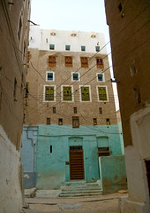 Turquoise Front Of A Five To Six Storey Building In The Old Town Of Shibam, Yemen (Eric Lafforgue) Tags: arabia arabiafelix arabianpeninsula arabic architectural architecture blue brick building builtstructure city colourpicture day facade fortifiedwall green hadhramaut hadhramawt hadhramout hadramaout hadramaut hadramawt historical history house housing manhattanofthedesert middleeastern mudbrick nopeople outdoors placeofinterest shibam skyline skyscraper themanhattanofthedesert town traveldestinations unescoworldheritagesite vertical wire woodendoor yemen mg6338