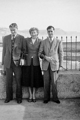Lovely lady with two handsome gents (vintage ladies) Tags: vintage blackandwhite photograph photo man male men lady lovely smile smiling suit tie handbag jacket stylish 50s 50slady 50swoman 50sstyle 50sman coast seaside