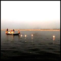 Ganges Lamps (bandarji) Tags: india vacation family varanasi night boat river ganges