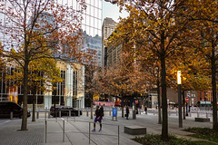 At the End of the Day (Jocey K) Tags: sonydscrx100m6 triptocanadaandnewyork architecture buildings sky clouds reflections 911memorialplaza trees autumn autumncolour whiteoaktrees people evening newyorkcity